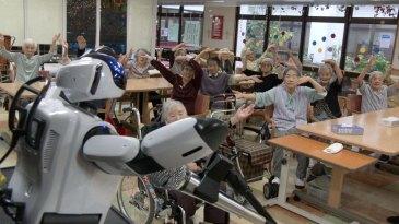 NHK World TV - Robot leads an exercise class for the  elderly